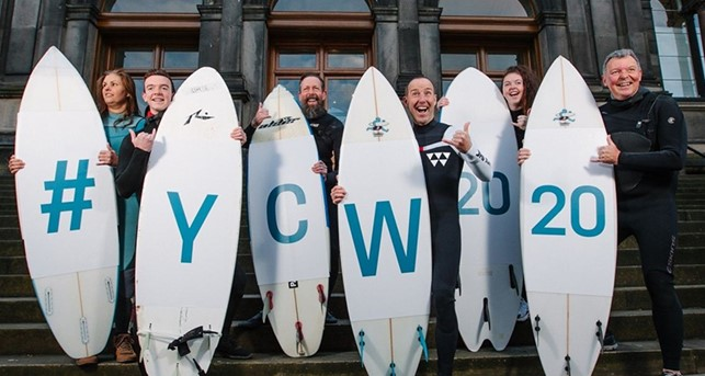 Surfers with surf boards with #YCW2020 spelled across them copyright of VisitScotland