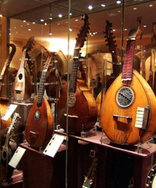 String instruments in a glass case at St Cecilias